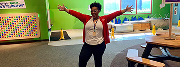Science Center staff member smiling in the Little Learners Clubhouse