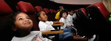 Children looking up in the planetarium