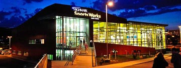 Night time exterior view of Highmark Sports Works